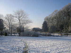 Congleton Park in Winter, with snow on the ground. The shot is taken from the East side of the Park towards the Pavilion.